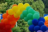 Rainbow balloons adorned the float